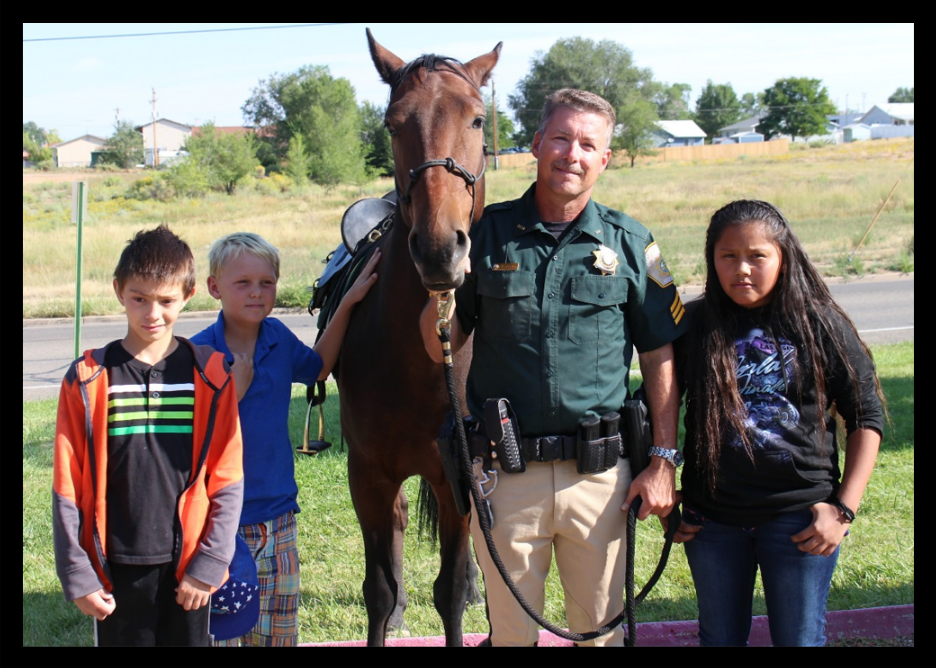 Nathan Hackett, Jake Nelson and Terriah Lansing from Mesa Elementary School picked out Charley's name. They are pictured with Sergeant Edward Oxley and Charley.